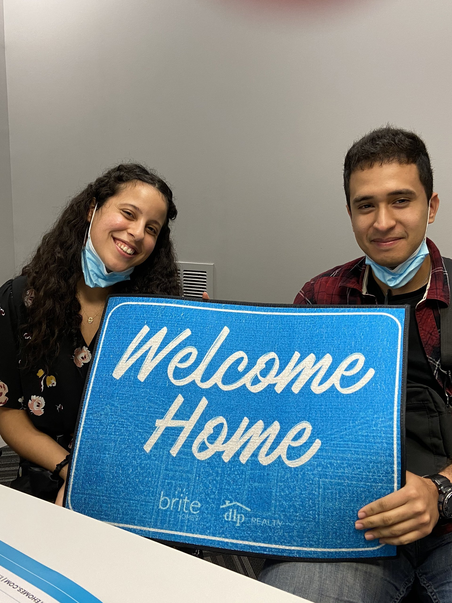 Couple at closing of a home